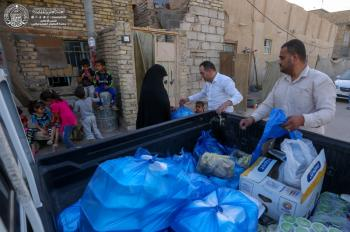 The Secretariat of the Holy Shrine of Imam Ali (PBUH) Distributes Iftar Meals for the Needy Families