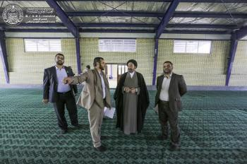 Secretary General of Imam Ali Holy Shrine views firsthand Imam Ridha City Project for visitors.
