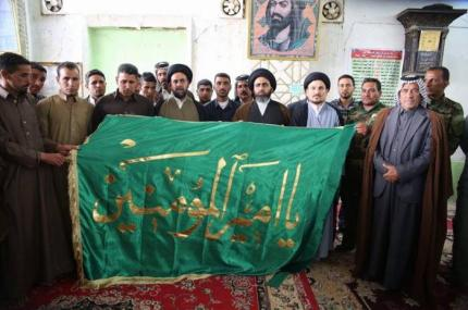 Presenting the banner of Imam Ali to the family of Sheikh of martyrs