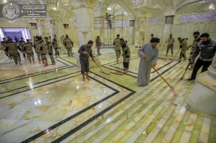 Secretary General of Imam Ali Holy Shrine participates with the employees of External and Internal Services Department in preparing the third stage of Worship and Pray Part of Western Expansion Project – Sahan (Courtyard) Fatima (Peace be upon her)
