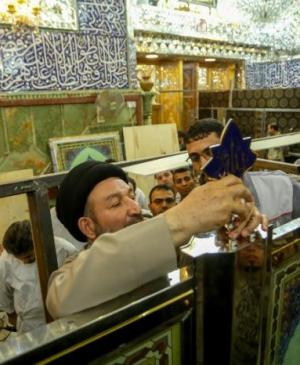 Glassy Partitions were Put up near the Holy Grave of the Commander of the Faithful (PBUH)